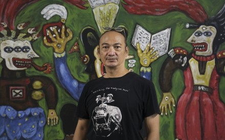 Indonesian artist Heri Dono, pictured here in front of his 2015 work 'Between two cards', is currently exhibiting at Tang Contemporary Art in Central. Photo: James Wendlinger