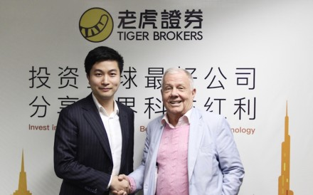 Tiger Brokers' chief executive Wu Tianhua (left) and US investment guru Jim Rogers. Photo: Handout