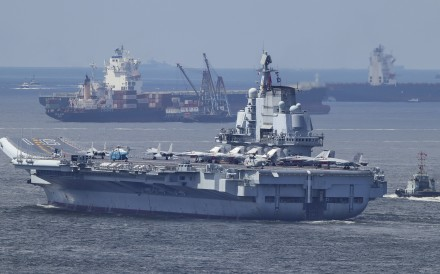 The Liaoning pictured leaving Hong Kong waters on Tuesday. Photo: Roy Issa