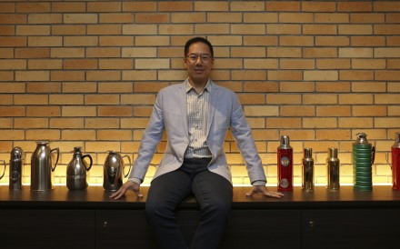 Raymond Leung with a display of Camel vacuum flasks at the Camlux Hotel, opened in the former flask factory. Photo: Jonathan Wong