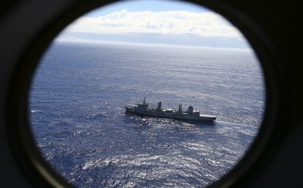 HMAS Success scans the southern Indian Ocean, near the coast of Western Australia, as a Royal New Zealand Air Force P3 Orion flies over, while searching for missing Malaysia Airlines Flight MH370. Photo: AP