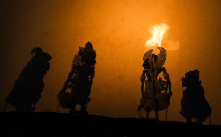 Many authentic Bali shadow puppet performances use firelight for illumination behind the screen. Photo: David Burden