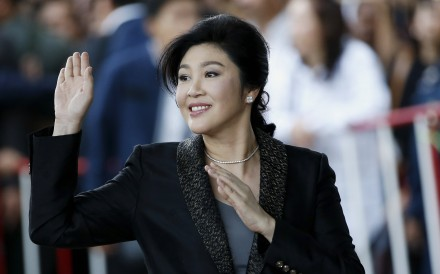 Yingluck Shinawatra waves to supporters as she arrives to deliver closing statements in her trial at the Supreme Court in Bangkok. Photo: EPA