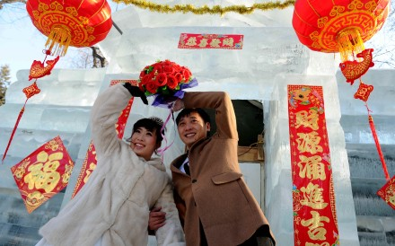 A happy couple ties the knot in this file photo. Marriage rates have been in decline across China in recent years, while the number of people getting divorced has soared. Photo: Xinhua