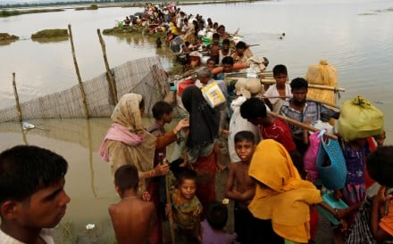 Rohingya refugees wait for boat to cross a canal after crossing the border through the Naf river in Teknaf, Bangladesh. Photo: Reuters