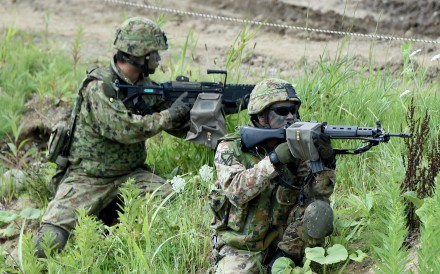 Japanese soldiers take part in a drill with US marines in Hokkaido in August. Photo: AFP