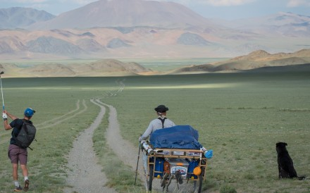 Adam Rolston hits one of over 20,000 strokes as he and caddie Ron Rutland golf across Mongolia. Photo: Andrew King