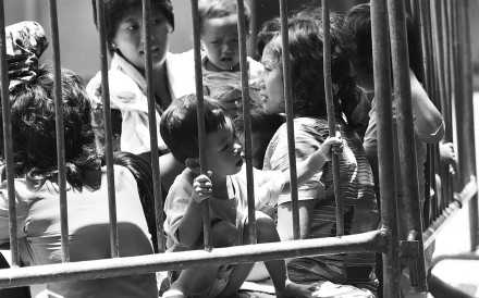 Women and children were among the many refugees kept behind bars upon arrival in Hong Kong. Photo: Handout