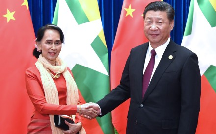 Aung San Suu Kyi meets Xi Jinping during an international conference in Beijing on Friday. Photo: Xinhua