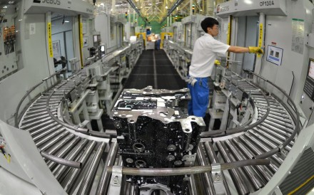 An employee at GM's Wuhan factory in central China's Hubei province. China is expected to set a flexible GDP growth target of between 6 to 6.5 per cent for 2018. Photo: AFP