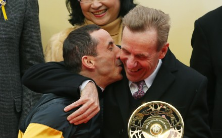 Olivier Doleuze plants a kiss on John Size's cheek after winning the Group One Centenary Sprint Cup with D B Pin. Photos: Kenneth Chan