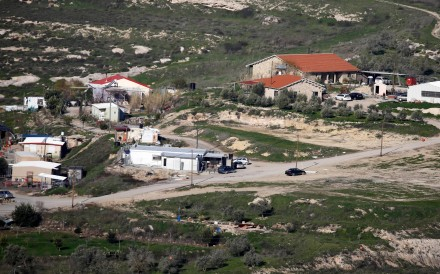 """A picture taken from the outskirts of the Palestinian city of Nablus shows a view of the """"wildcat"""" Jewish settlement outpost of Havat Gilad. Photo: AFP"""