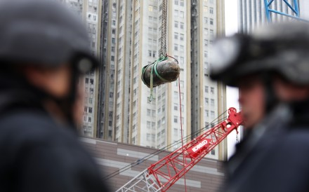 A bomb from the second world war is removed from the Sha Tin-Central rail link construction site in Wan Chai. Photo: Sam Tsang