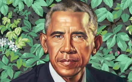 Former US president says he tried to negotiate smaller ears and less grey hair, while praising portrait of wife Michelle Obama for capturing her 'hotness'