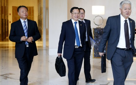 China's ambassador to the Philippines, Zhao Jianhua (left), and other Chinese foreign ministry officials head for talks in Manila. Photo: AP