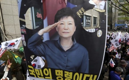 Supporters of former South Korean president Park Geun-hye call for her release near the Seoul Central District Court. Photo: AP