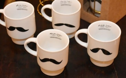Mugs with the signature moustache of the Sarkies brothers from the E&O Hotel. Photo: Handout