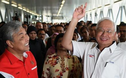 Malaysian Prime Minister Najib Razak, right, and Deputy Prime Minister Ahmad Zahid Hamidi at the launch of the Sungai Buloh-Kajang MRT line, in Kuala Lumpur last July 17. Photo: AFP