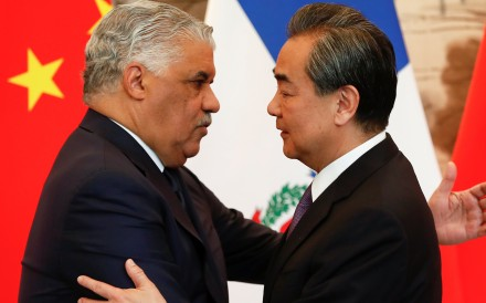 Chinas State Councillor And Foreign Minister Wang Yi Right Hugs The Dominican Republics Chancellor