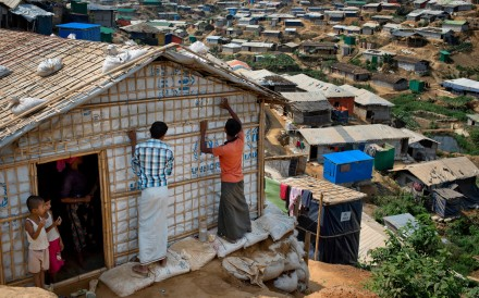 Rohingya refugees rebuild their makeshift house, in preparation for the approaching monsoon season at the Kutupalong Rohingya refugee camp in Kutupalong, Bangladesh on April 28. Photo: AP