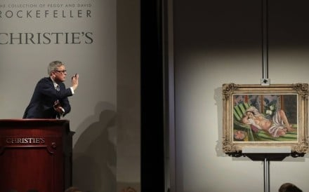 Global president of Christie's Jussi Pylkkanen taps the gavel on the podium for the final sale of Henri Matisse's 'Odalisque couchee aux magnolias' for US$71.5 million during the auction from the collection of Peggy and David Rockefeller in New York on May 8. Photo: AP