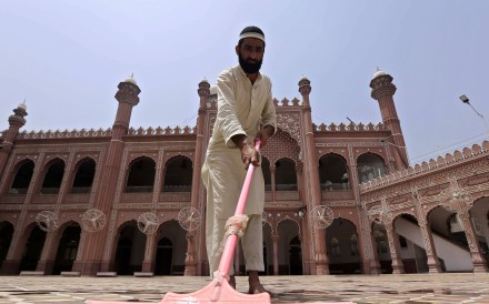 A man cleans a Mosque in Peshawar, Pakistan ahead of the Muslim holy fasting month of Ramadan. Photo: EPA