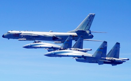 A Chinese H-6K strategic bomber, like the one shown here accompanied by two Su-35 fighter jets, recently took part in landing exercises on an island reef in the South China Sea, according to the PLA Air Force. Photo: Xinhua