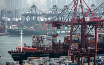 Container ships next to shipping containers at Kwai Tsing Container Terminals in Hong Kong. Photo: Bloomberg