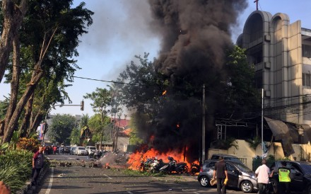 A handout photo made available by the Government of Surabaya shows a burning vehicles shortly after a bomb blast at a church in Surabaya, East Java, Indonesia, on May 13. Photo: Surabaya Government via EPA-EFE