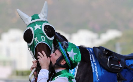 Tommy Berry kisses Pakistan Star after winning the Group One Champions & Chater Cup. Photos: Kenneth Chan
