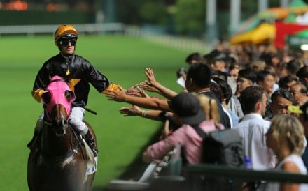 Zac Purton celebrates Top Score's victory with the fans at Happy Valley. Photos: Kenneth Chan