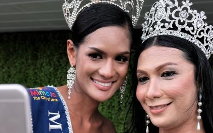 Asan Sohoh (left) and Ardulmalik Maskul, two transgender women from Muslim majority southern Thailand take a selfie. Photo: Tibor Krausz