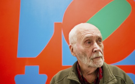 US artist Robert Indiana, pictured here in front of one of his paintings at New York's Whitney Museum of American Art, is known the world over for his Love images. Photo: AP