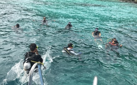 Members of Thai and Chinese rescue team search for missing passengers from a capsized boat in Phuket, Thailand, on Sunday. Photo: Xinhua