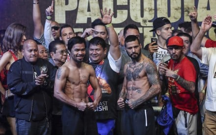 Filipino senator and boxing icon Manny Pacquiao and Argentina's Lucas Matthysse pose at the weigh-in in Kuala Lumpur. Photo: EPA