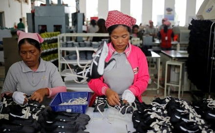 Women earn US$240 a month making shoes for American, British and Japanese brands. Photo: Reuters