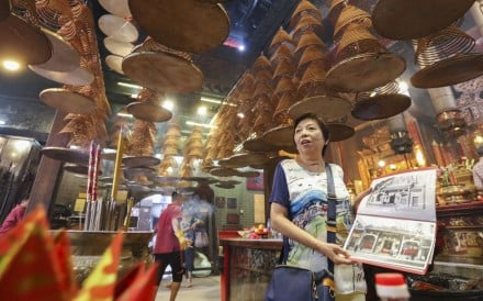 Leung King-foon, 69, visits a temple during a walking tour of Hung Hom. Photo: Felix Wong