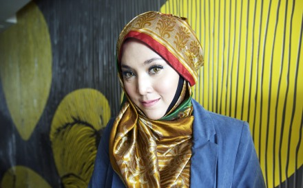Shila Amzah is a fashion inspiration for millions of young Muslim women worldwide. Her colourful hijabs are a refreshing counterpoint to her international outlook. Photo: Vicky Feng