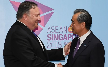 US Secretary of State Mike Pompeo and China's Foreign Minister Wang Yi shake hands before their bilateral meeting at the 51st Association of Southeast Asian Nations in Singapore. Photo: Reuters