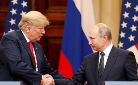 US President Donald Trump and Russian President Vladimir Putin shake hands as they hold a joint news conference after their meeting in Helsinki, Finland, on July 16. US Special Counsel Robert Mueller is investigating allegations of Russian interference in the 2016 presidential election. Photo: Reuters