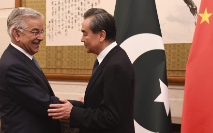Pakistan's Foreign Minister Khawaja Muhammad Asif (left) shakes hands with Chinese Foreign Minister Wang Yi at the Diaoyutai State Guest House in Beijing on April 23. Photo: AFP