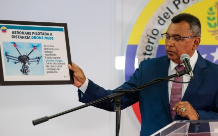 Venezuela's Interior and Justice Minister Nestor Reverol holds a placard with a picture of a drone during a news conference in Caracas about the drone attack on President Nicolas Maduro. Photo: Reuters.
