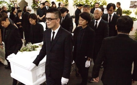 Singer Denise Ho (left) and music industry veteran Anthony Wong (front) were pallbearers at the service. Photo: Handout