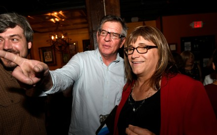 Vermont Democratic Party gubernatorial primary candidate Christine Hallquist (right), a transgender woman, attends her election night party with Matt Cropp, left, and Val Davis, in Burlington, Vermont. Photo: Reuters