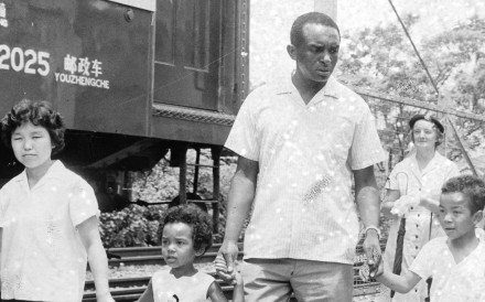 Former US soldier William White and his family crossing the border into Hong Kong at Lo Wu in August 1965.