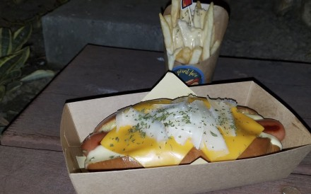 The triple cheese hot dog and fries with cheese sauce at Nine Point Five, Sai Kung, Hong Kong. Photo: SCMP