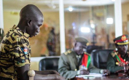 A South Sudanese soldier listens to his verdict at the military court in Juba, South Sudan, on Thursday. The military court found 10 soldiers guilty of raping five foreign aid workers and murdering a local journalist during fighting in Juba in July 2016. Photo: Agence France-Presse