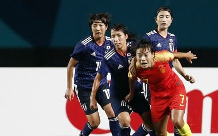 Wang Shuang of China battles with Japan players in the 2018 Asian Games women's football final. Photo: Reuters