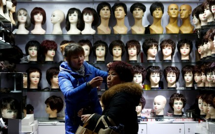 A wig shop in Shanghai. China is the second-largest exporter of human hair to the US, which is often processed into wigs. The category was exempt from new tariffs published on Monday in America. Photo: Reuters