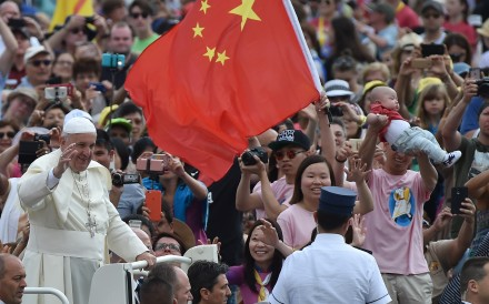 Pope Francis greets a crowd at St Peter's Square in the Vatican City, including a member of the faithful waving a Chinese flag. By one estimate, China's Christian population has swelled from a few million in the early 1980s to 100 million this year – in comparison, the Communist Party has 90 million members. Photo: AFP